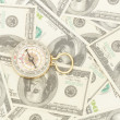 Dollars and compass. - Stock Photo