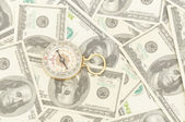 Dollars and compass. — Stock Photo