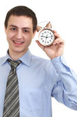 Businessman with an alarm clock in a hand. — Stock Photo