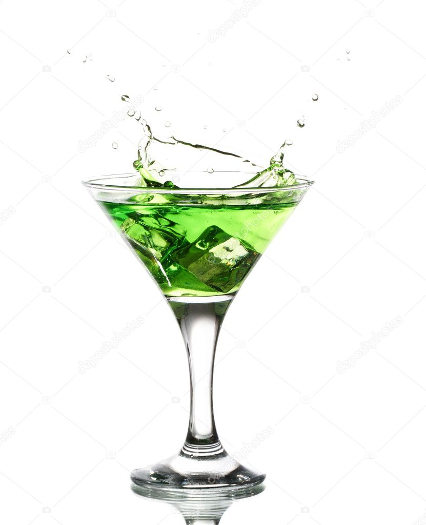 Green martini cocktail splashing into glass on white background — Stock Photo #5223734