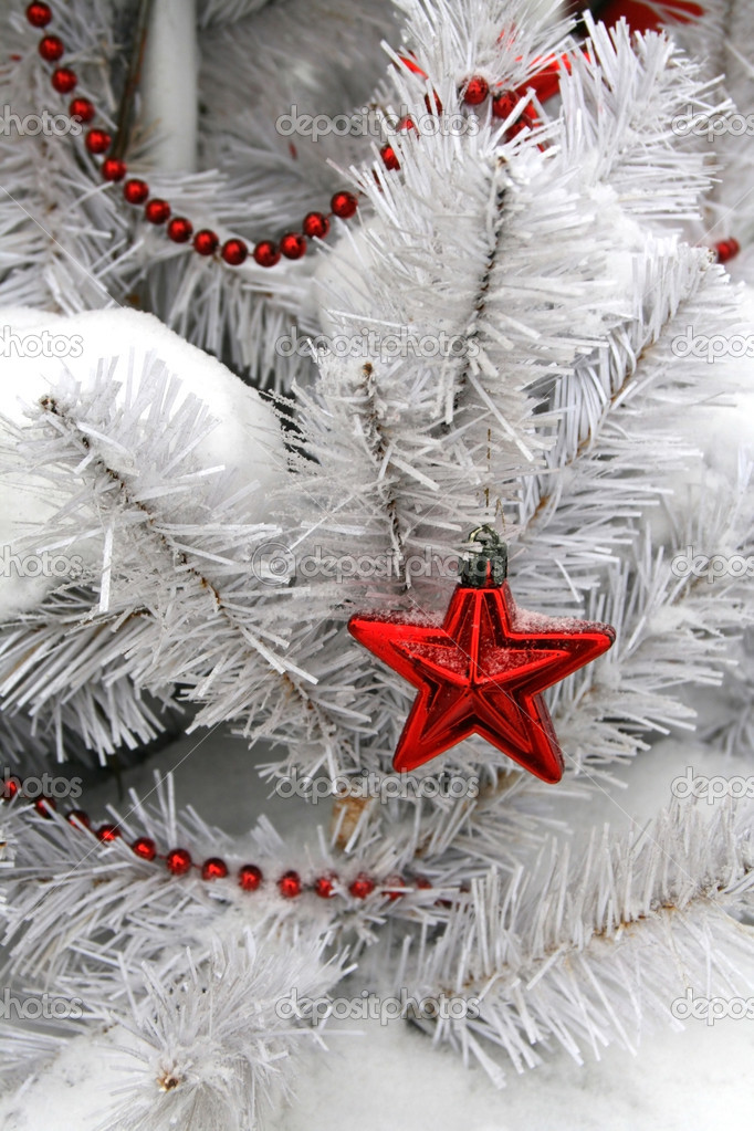 White Christmas spruce decorated with a red star. — Stock Photo #4510322