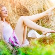 The young sexy girl rejoices to summer on a mow. — Stock Photo