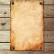 Vintage page on a wooden wall — Stock Photo