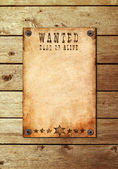 Vintage wanted poster on a wooden wall — Стоковое фото