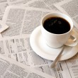 Постер, плакат: Coffee over newspaper