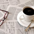 Coffee over newspaper — Stock Photo #4885907