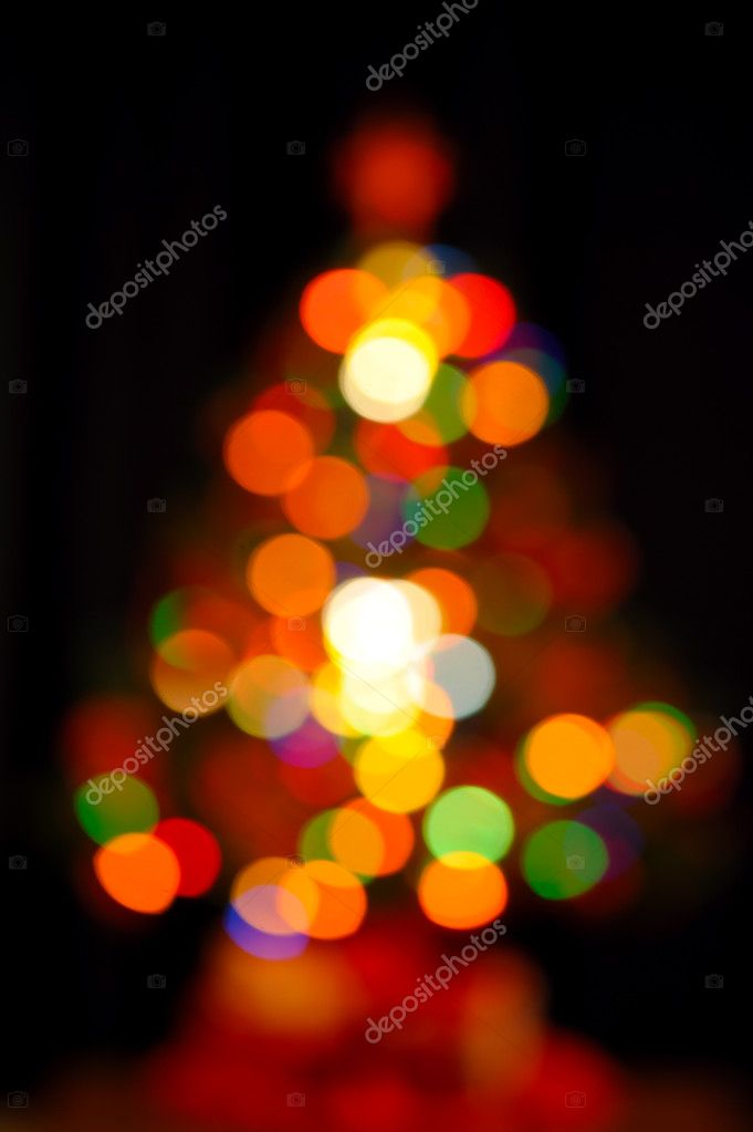 Colorful fir shape christmas light on dark background — Stock Photo #4354042