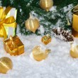 Golden Christmas on snow — Stock Photo