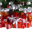 Red gift boxes under Christmas tree — Stock Photo