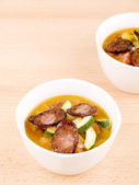 Two bowls of tasty homemade spicy soup — Stock Photo
