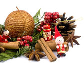Christmas decoration - wooden figure, candle and thuja branches — Stock Photo