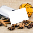 Stock Photo: Christmas orange, spices and white notecard