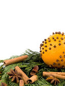 Christmas decoration - orange with spices and thuja branches — Stock Photo