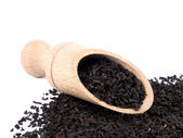 Aromatic black tea and wooden shovel — Stock Photo