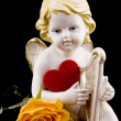 图库照片: Ceramic cupid on black background