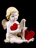 Ceramic cupid on black background — Stock Photo