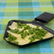 Stock Photo: Raclette pwith cheese and spring onion - party food