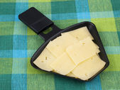 Raclette pan with cheese — Stock Photo