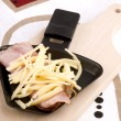 Stock Photo: Raclette pwith cheese and ham - party food