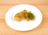 Fried chicken leg on white plate — Stock Photo
