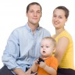 Young parents sit near the child — Stock Photo