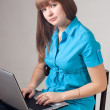 Stock Photo: Girl works at computer.