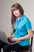 The girl works at the computer. — Stock Photo