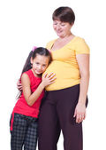The girl listens to a stomach of mother — Stock Photo