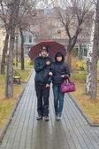 The pair walks on square — Stock Photo