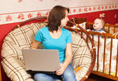 Mother works at home — Stock Photo