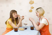 Two girls having tea — Stock Photo