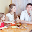 Family on kitchen — Stock Photo