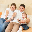 Family in front of the TV — Stock Photo #4657394