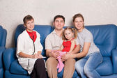The doctor and happy family — Stock Photo