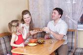 Family on kitchen — Stock Photo