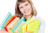 The girl with a heap of books — Stock Photo