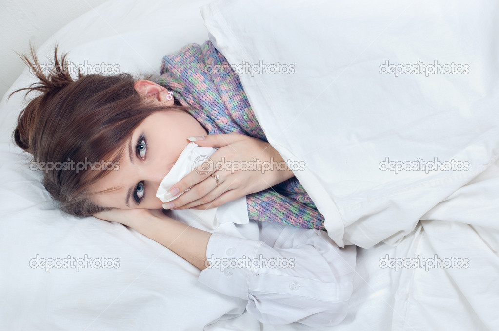 Girl with a cold in bed  Stock Photo #5013097