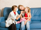 A doctor examining a child — Stock Photo