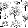 Set of silhouettes of trees — Vettoriali Stock