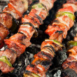 Barbecue with raw meat skewers - Stockfoto