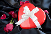 Red Rose and Heart-shaped Gift Box with Ribbon — Stock Photo