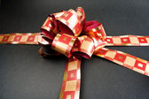 A red ribbon tied in a bow — Stock Photo