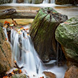 Small waterfall in autumn river — Stock Photo