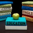 Education study books and apple — Stock Photo