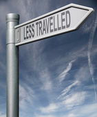 Less travelled sign clipping path — Stock Photo