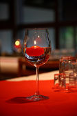 Glass for wine and candle. — Stockfoto
