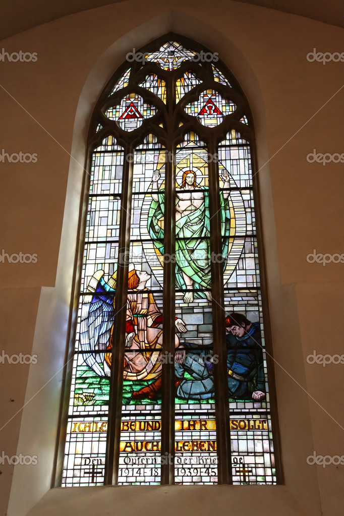 Stained glass window at the catholic church.  Stock Photo #4333776