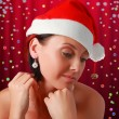 Beautiful woman in Christmas hat. — Stock Photo