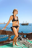 Girl and sailing ship. — Stock Photo