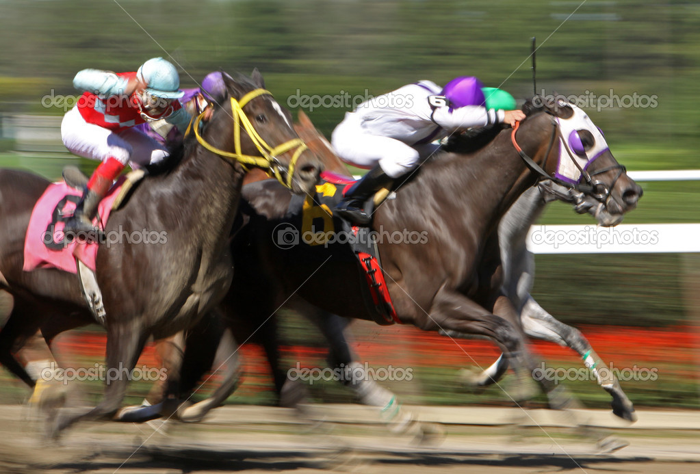 Slow shutter speed rendering of racing horses and jockeys. — Stock Photo #4015780